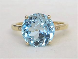 9k Yellow Gold 6.6ct Blue Topaz & Diamond Ring